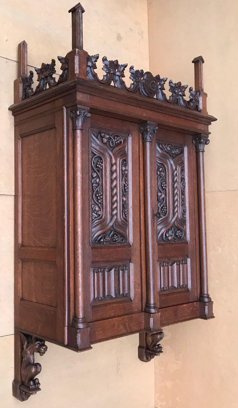 Antique Gothic Revival Hand Carved Oak Wall Cabinet with Gargoyles Sculptures For Sale 2