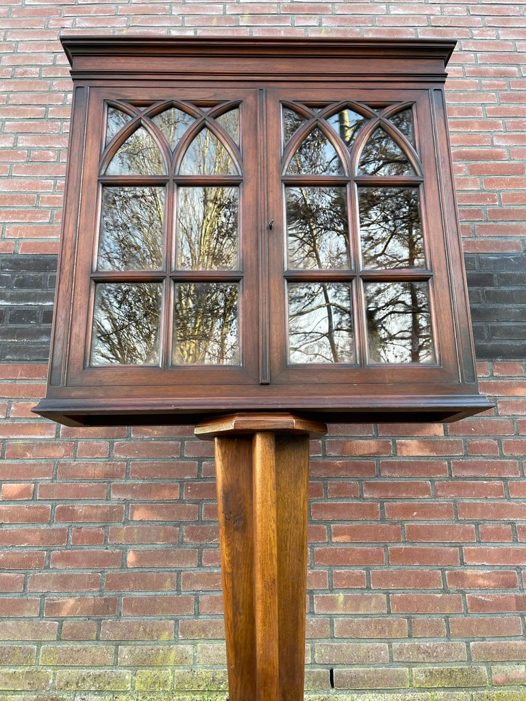 Unique and amazing wall cabinet with church window like doors.  This handcrafted and rare Gothic Revival wall cabinet from the late 1800s is another one of our magnificent recent finds. The size, the quality of the make and the calm Gothic design