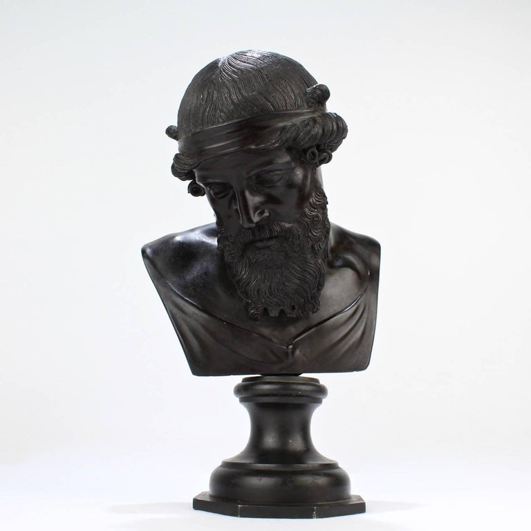 A very good, antique Grand Tour bronze bust of Dionysius.  Modelled after the ancient bust from the Villa of the Papyri at Herculaneum.  The model is occasionally, alternately identified as Plato or Poseidon.  Measures: Height ca. 10 1/2