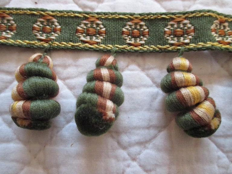 Antique green and gold trim and tassel Passementerie. Woven wool and silk. Ideal for pillows, window shade trim, upholstery or lampshades. Size: 2.5
