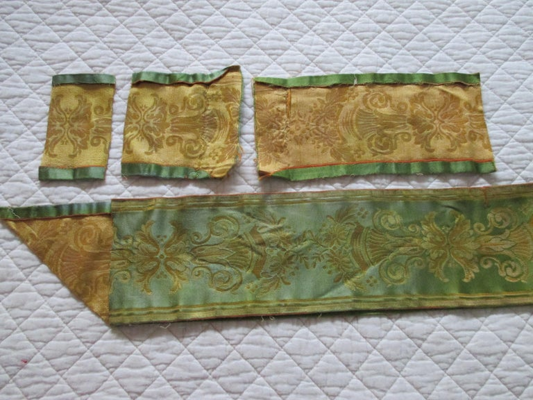Antique green and gold woven silk French ribbon. Depicting urns with flowers. (4) piece lot sold as is. Ideal for pillows and upholstery Size from: 5