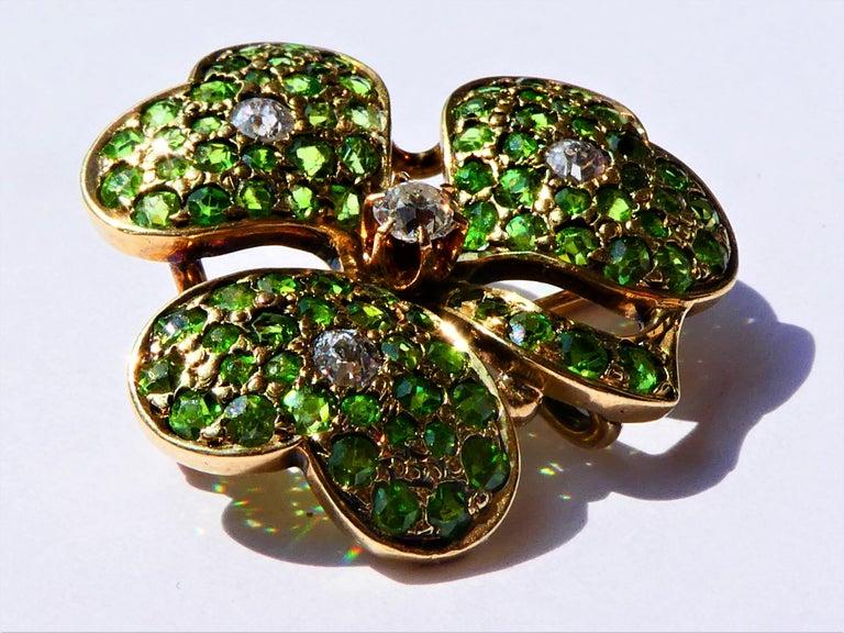Old Mine Cut Antique Green Demantoid Garnets and Diamonds 14 Karat Gold Cloverleaf Brooch For Sale