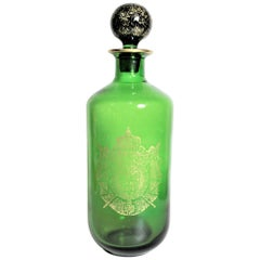 Antique Green Napoleonic Styled French Bottle Decanter with a Large Gilt Crest