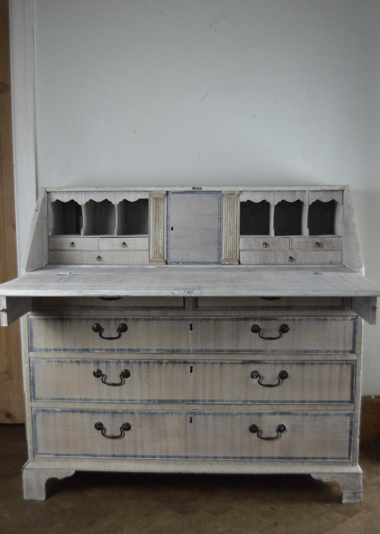 Great limed oak Georgian secretary or bureau in Gustavian style.  Limed oak and mahogany cross banding.  Very attractive interior.  Original brass hardware.  The piece has been recently limed.