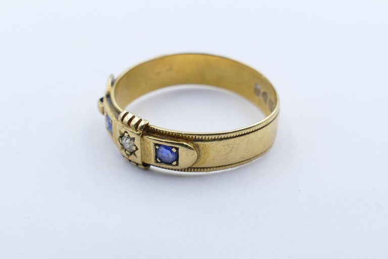 Victorian Antique Hallmarked 18 Carat Yellow Gold Blue Sapphire and Diamond Buckle Ring For Sale