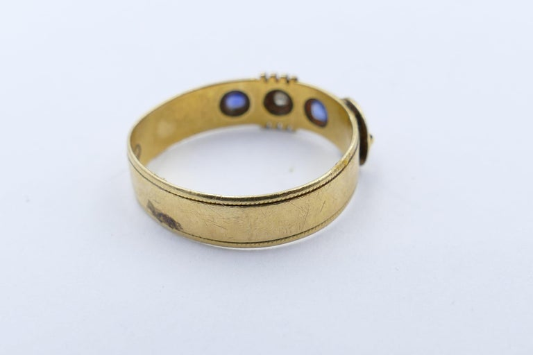 Mixed Cut Antique Hallmarked 18 Carat Yellow Gold Blue Sapphire and Diamond Buckle Ring For Sale
