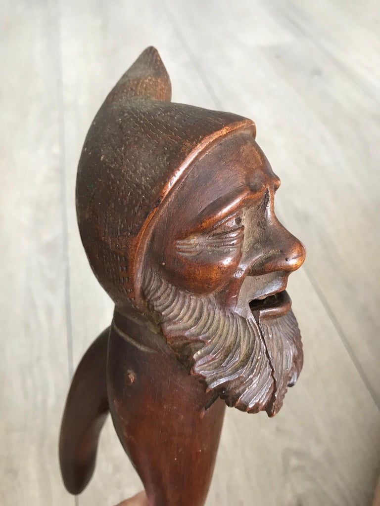 Top quality carved, early 20th century, wooden Black Forest nut cracker.   If you are a collector of only the best quality and condition Black Forest antiques then this gnome nut cracker could be the perfect addition to your collection. This antique