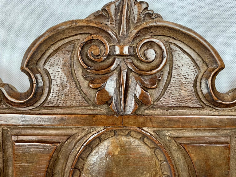 Antique hand carved walnut panel. Interesting scrolls and leaves atop a raised panel enclosing a convex oval. The side motif is again of scrolls topping a floret. If you look closely you can see the obvious differences of hand carving. Some of the