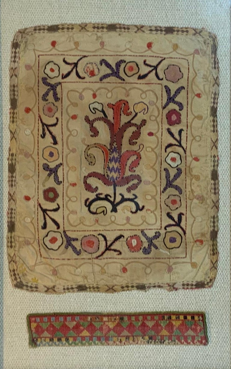 Beautiful antique Suzani textile embroidery made by nomadic Turkmen tribe as a sampler for probably of larger Suzani design, or just for decorative use, show the mastery of the art of Asian embroidery. On the bottom is displayed handmade man