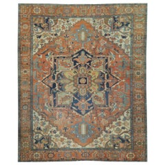 Antique Hand Knotted Wool Red and Blue Persian Serapi Rug