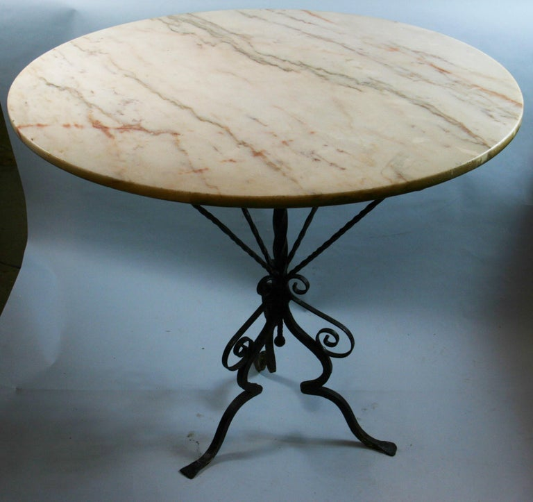 3-621 Italian hand made iron based table with marble top Can be used a center table or breakfast table.