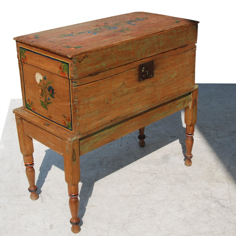 Antique, hand painted Mexican wedding or hope chest on stand  Features beautiful hand painted accents throughout, as well as a locking mechanism. Locking mechanism appears to be a more recent addition to this piece.