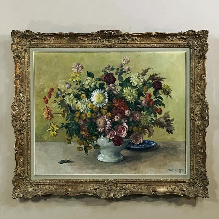 This exquisite antique still life floral painting is an original oil on canvas by artist Marcel Van Cauter who was born in 1919. Survives in its original frame! One of these lovely antique paintings we discovered Inart collection with the signature