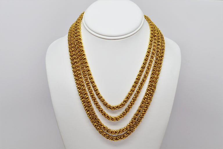Truly extraordinary describes the remarkable yards of fourteen karat 14K yellow gold that creates this antique double cable chain necklace. Measuring seventy eight (78) inches long, this continuous length of handmade chain, at 5.3 mm in heft, is