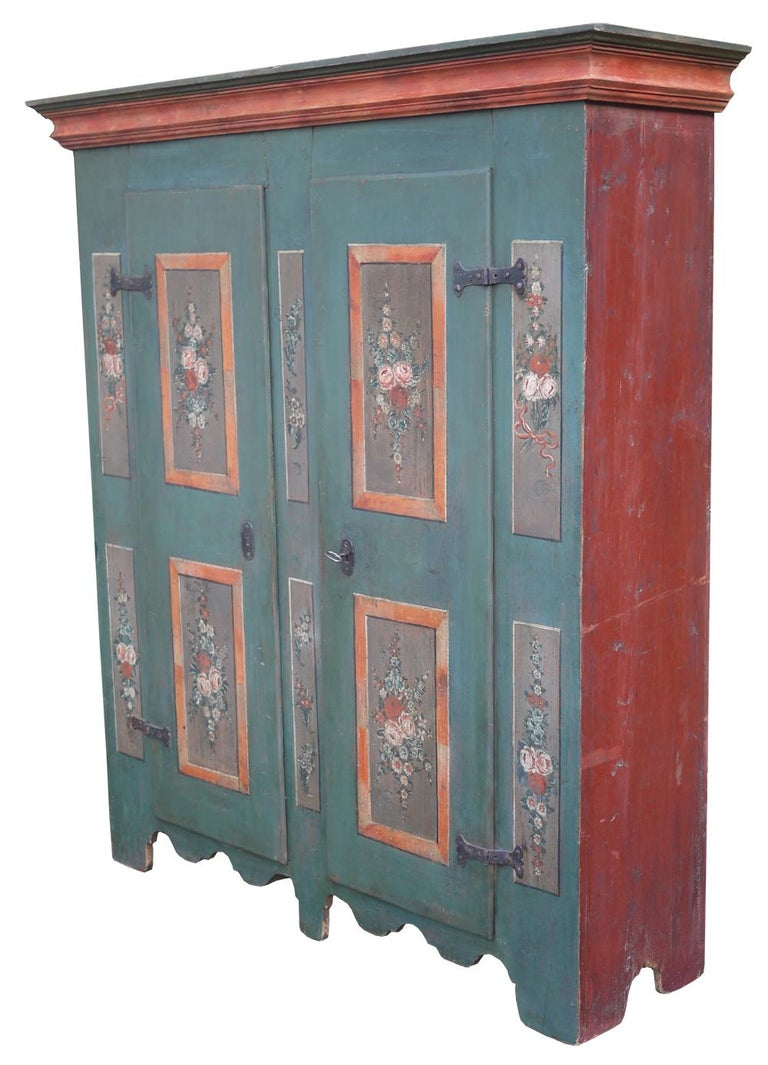 Two doors painted wardrobe  H.180cm – L.144cm (158 alle cornici) – P.40cm (47 alle cornici) H. 70.8 in - W. 56.6 in (62.2 to the frames) - D. 15.7 in (18.5 to the frames)  Tyrolean painted cabinet with two doors, with four main panels depicting