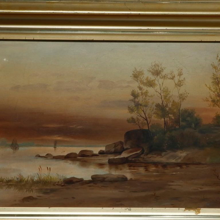 An antique Hudson River School landscape painting offers oil on canvas river or lake scene, seated in lemon gilt frame, c1860  Measures: 20.25