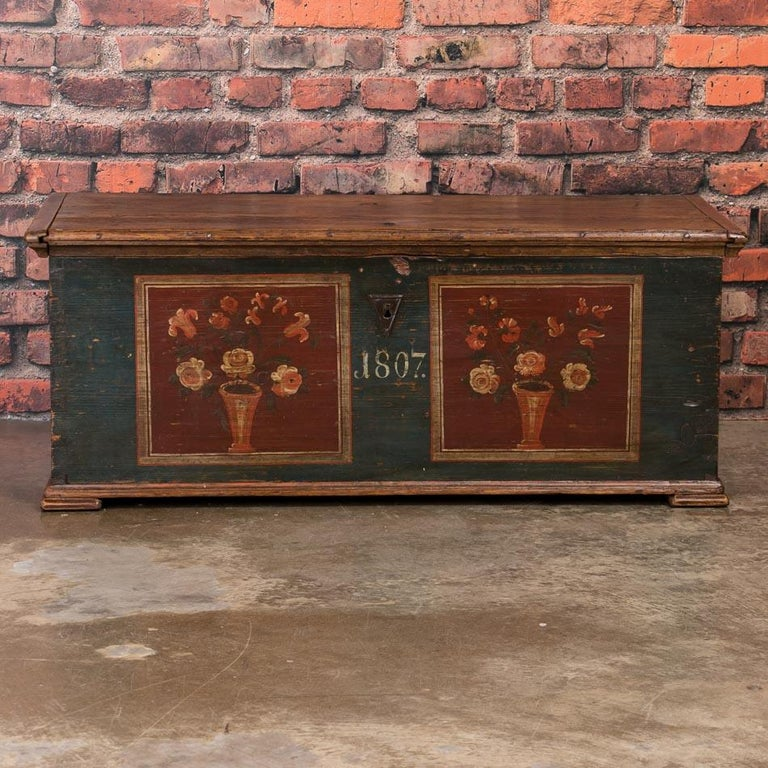 Utterly charming, this trunk is a special find due to its superb original paint which has been well preserved over years of use. The deep blue background and delightful floral details are wonderful examples of the traditional painting style in rural