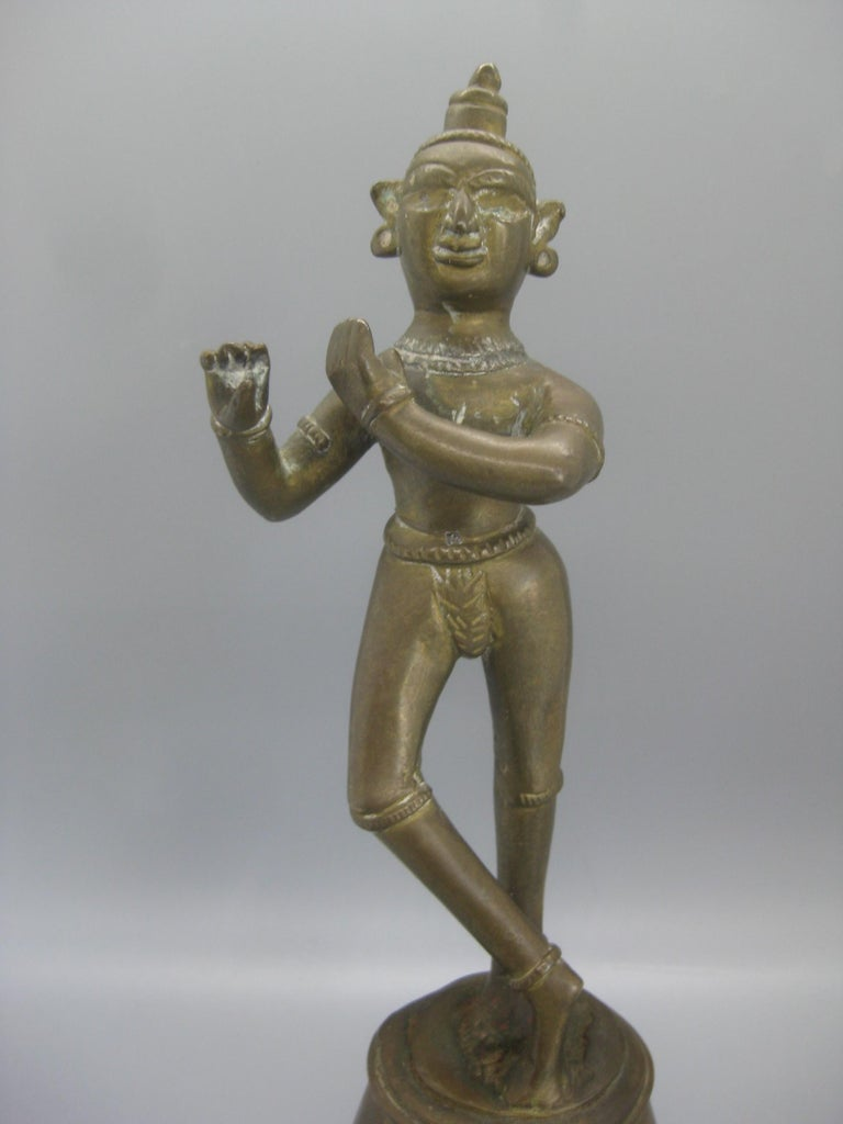Very unique antique India Hindu Lord Krishna standing statue sculpture. Made of brass and has a wonderful patina. This is a very old piece. In very nice original condition with no damage. Measures: approx. 9 3/4