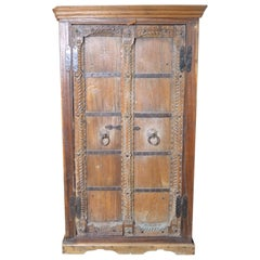 Antique Indian 19th Century Armoire with Metal Braces and Hand-Carved Decor