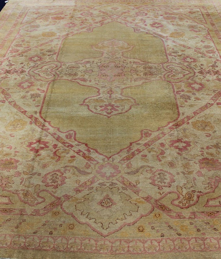 Antique Indian Amritsar rug in acidic yellow green, pink, ivory and brown highlights. rug / J10-0301. Antique Amritsar, antique Agra. Remarkable craftsmanship with regal designs and palette choices came out of India during the 19th century. The
