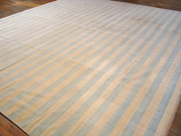 Sometimes the blue gets really pale, just a hint of sky in a borderless, edge-to-edge bitonal pattern on this all-cotton vintage Indian tapestry-woven carpet. Good condition.