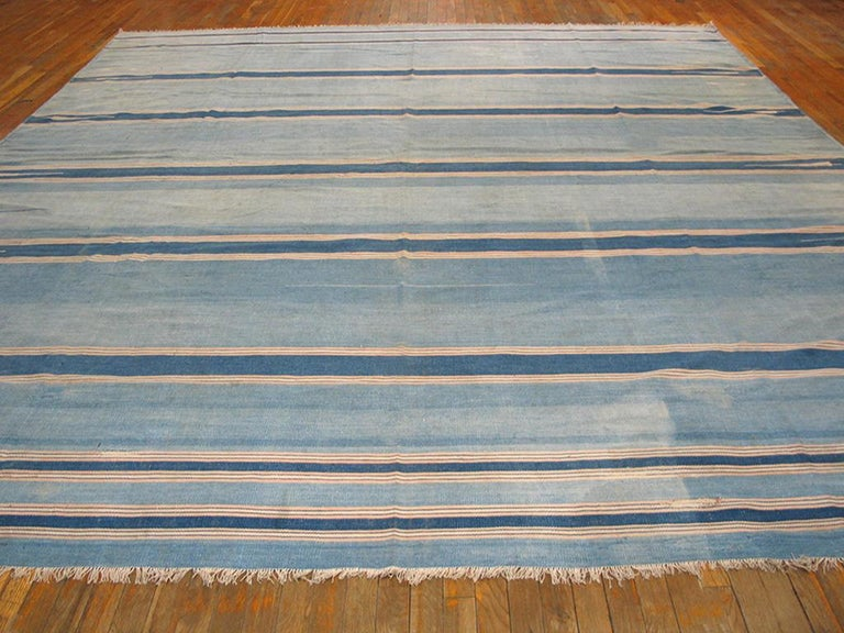 The denim blue, pale sky blue, ecru combo is probably the most popular Dhurrie palette type and here the bands and lines are broken only by side spearheads and a few tiny simple ashiks. And sandy-straw lines if you notice them. Good condition.