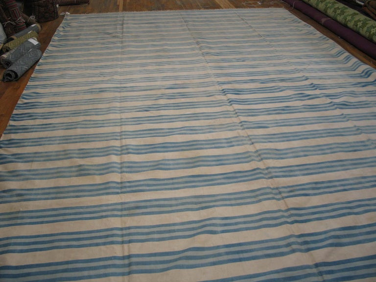 The overall pattern of triple light blue lines fades in and out, giving a hand washed character to this softly bitonal piece emphasizing the intermediate ecru stripes. Almost infinitely size adjustable. Good condition. All cotton construction.