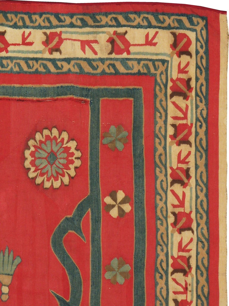 An antique Indian Dhurrie rug handwoven with cotton from the early 20th century.