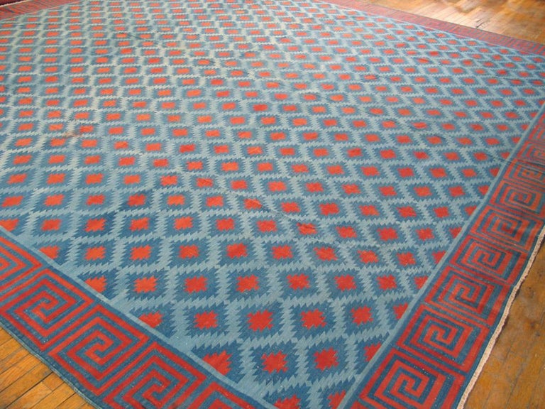 Our collection of antique and vintage Dhurries, including desirable square formats, is extensive, and this colorful example is a study in carefully abrashed light blue, with ashiks centered in red and edged in cerulean blue. Red and blue squared