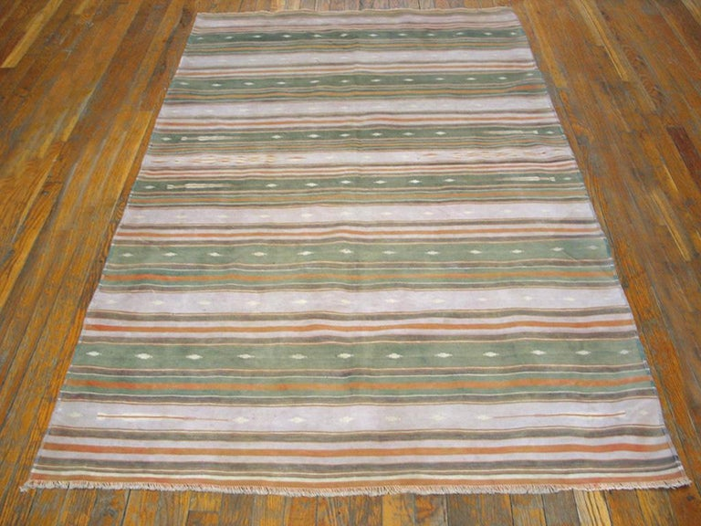 There are six wide, multiply-striped, and a run of very narrow stripers at each end. Finely woven, all-cotton construction and very versatile as a scatter or accent piece. Good condition. Measures: 4'0