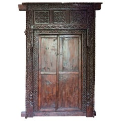 Antique Indian Ornately Carved Wooden Doors and Surrounding Frame