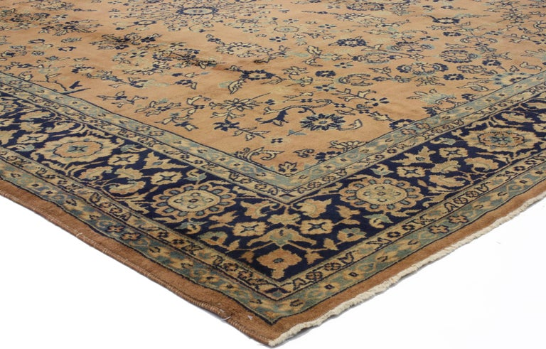 71981, antique Indian rug with traditional Persian style. This hand-knotted wool antique Indian rug with Traditional Persian style features an allover pattern meandering vines and blossoming flowers against an abrashed field. Delicate floral sprays