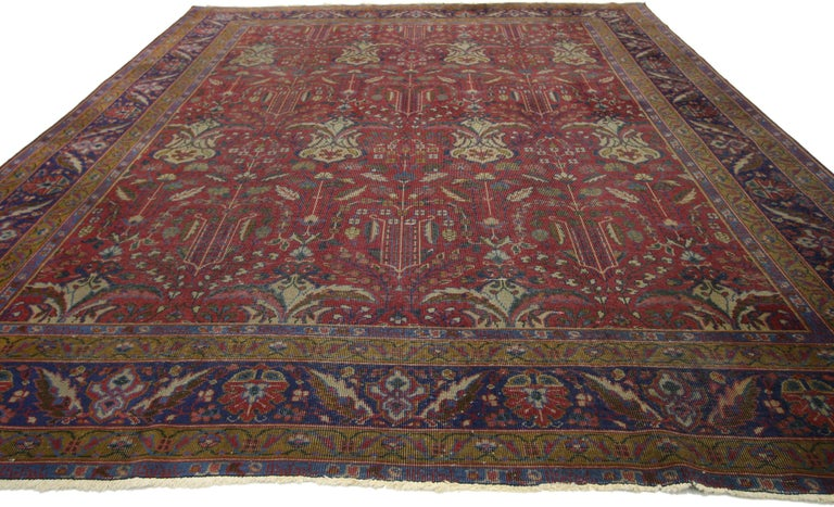 72879, antique Indian rug with traditional Victorian style and Mughal design. This hand knotted wool antique Indian rug features an all-over floral pattern spread across an abrashed ruby red field. Drawing inspiration from traditional Mughal