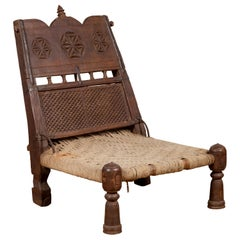 Antique Indian Rustic Low Seat Wooden Chair with Carved Rosettes and Twine Seat