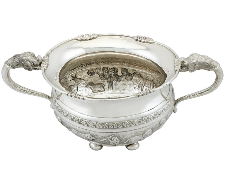 An exceptional, fine and impressive antique Indian silver sugar bowl; an addition to our silver teaware collection.  This exceptional antique Indian silver sugar bowl has a circular rounded, compressed form.  The body of this silver bowl is