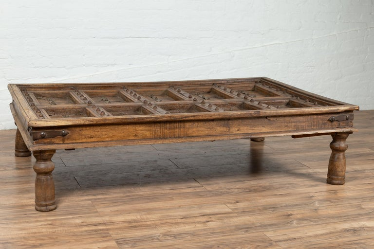 Antique Indian Wooden Palace Door Made into a Coffee Table with Iron Braces For Sale 6