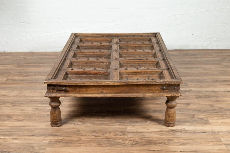 Rustic Antique Indian Wooden Palace Door Made into a Coffee Table with Iron Braces For Sale