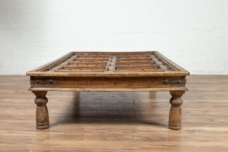 Antique Indian Wooden Palace Door Made into a Coffee Table with Iron Braces In Good Condition For Sale In Yonkers, NY