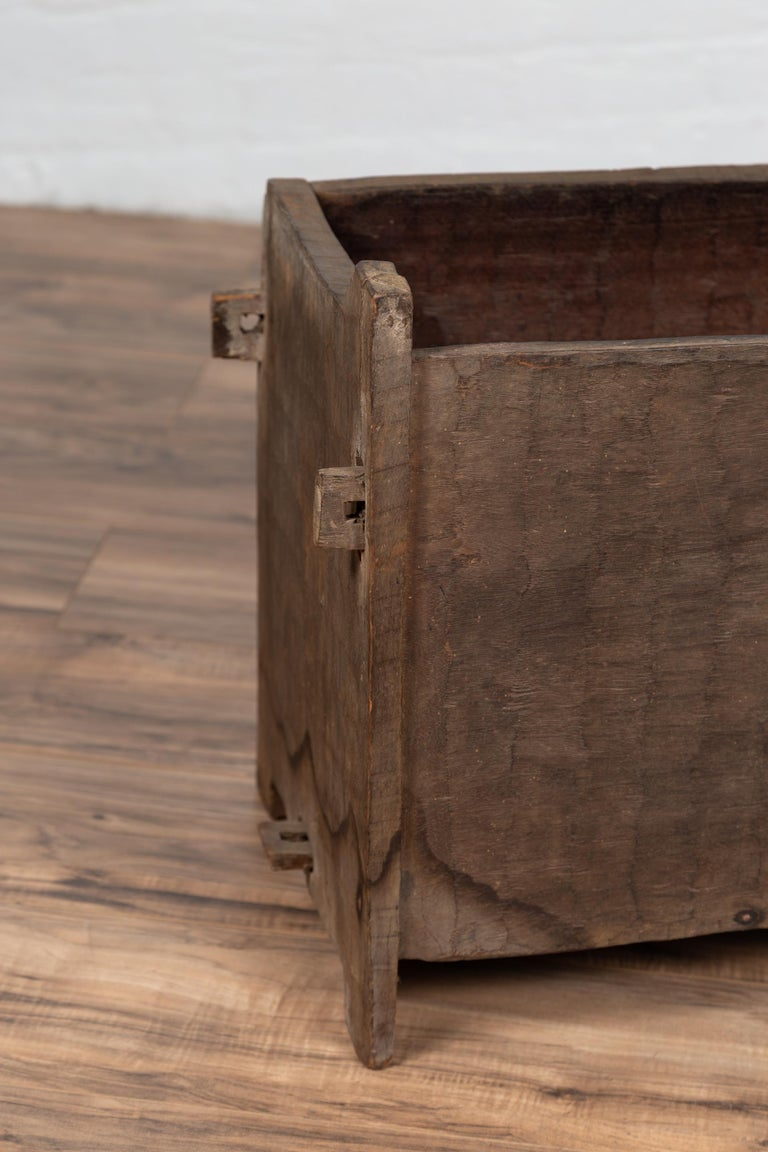 An antique Indian wooden planter box from the early 20th century with nicely weathered appearance. Born in India during the early years of the 20th century, this wooden planter box charms our eyes with its rustic appearance and irregular shape.