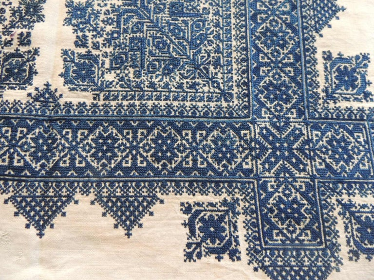 Antique indigo and natural woven and embroidered Fez textile fragment.