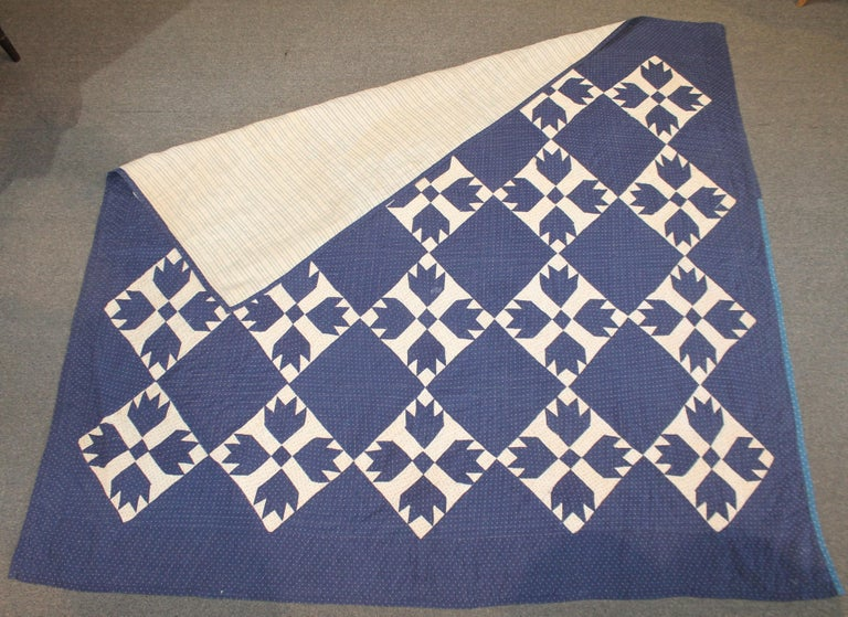 This 19th century bear paw pattern indigo blue and white calico fabric quilt is in fine condition. It was found in the mid west and has a grey flannel soft fabric backing. So a nice and durable quilt for using. Great to sleep with on a cold night !
