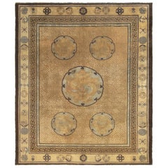 Antique Indochinese Gold and Black Medallion Rug with Floral Accents