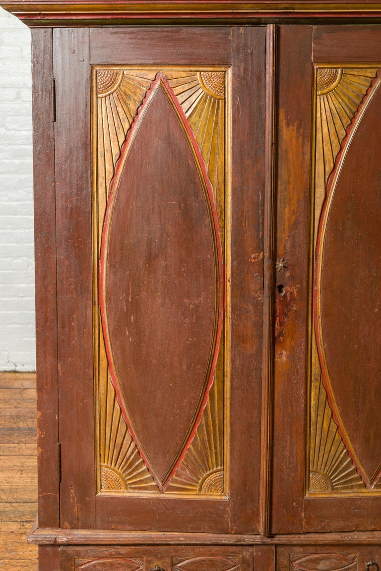 19th Century Antique Indonesian Cabinet with Carved Almond Style and Sun Ray Motifs For Sale