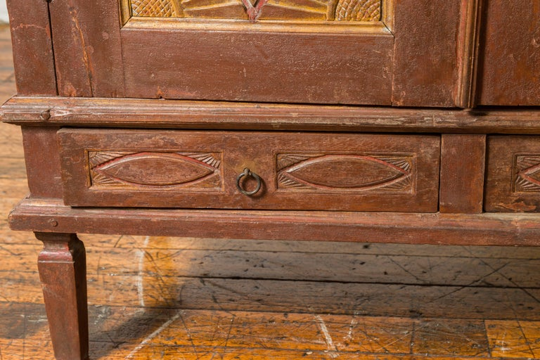 Antique Indonesian Cabinet with Carved Almond Style and Sun Ray Motifs For Sale 2
