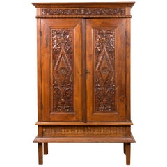 Antique Indonesian Cabinet with Carved Scrolling Foliage and Elongated Diamonds