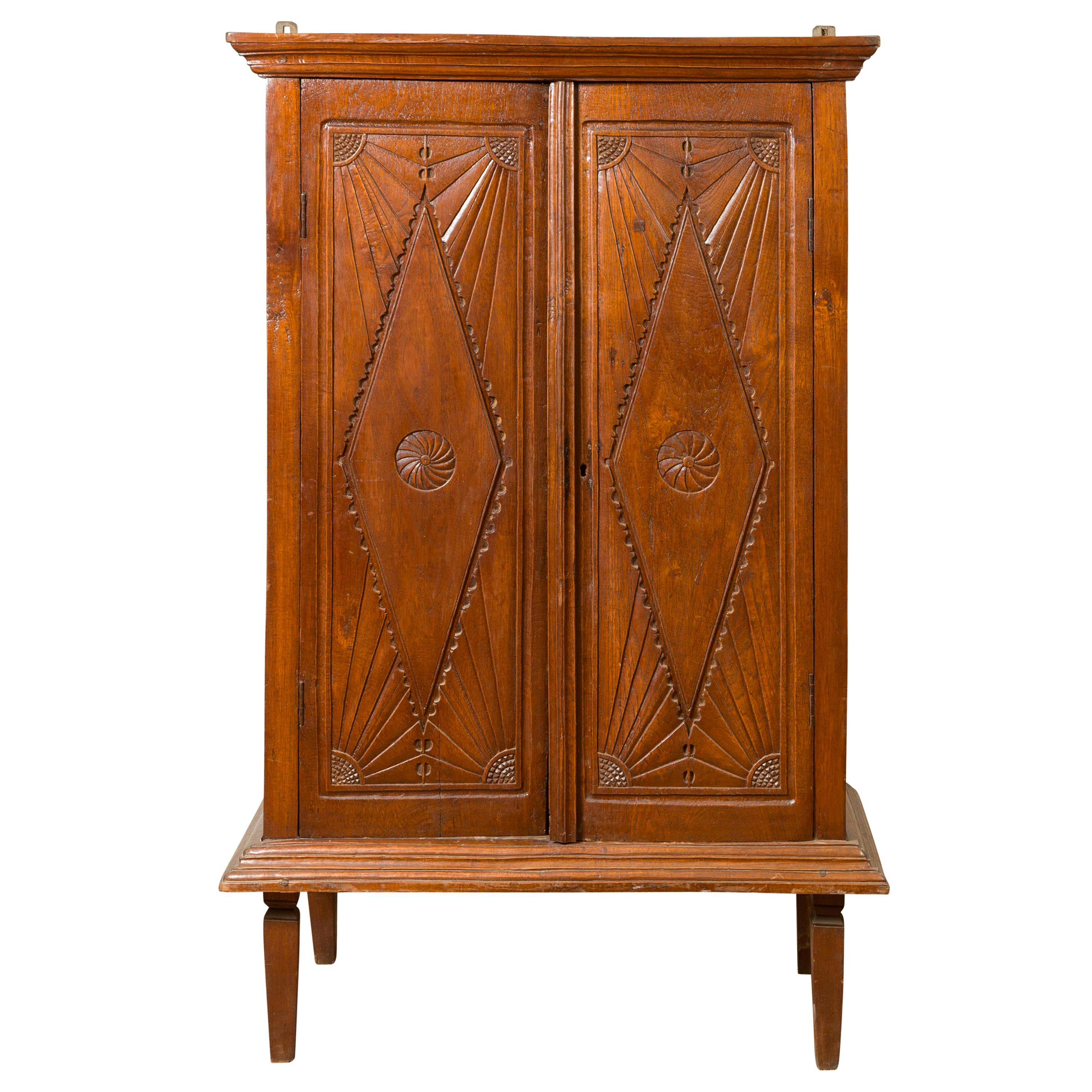 Antique Indonesian Carved Wooden Cabinet with Diamonds and Radiating Motifs