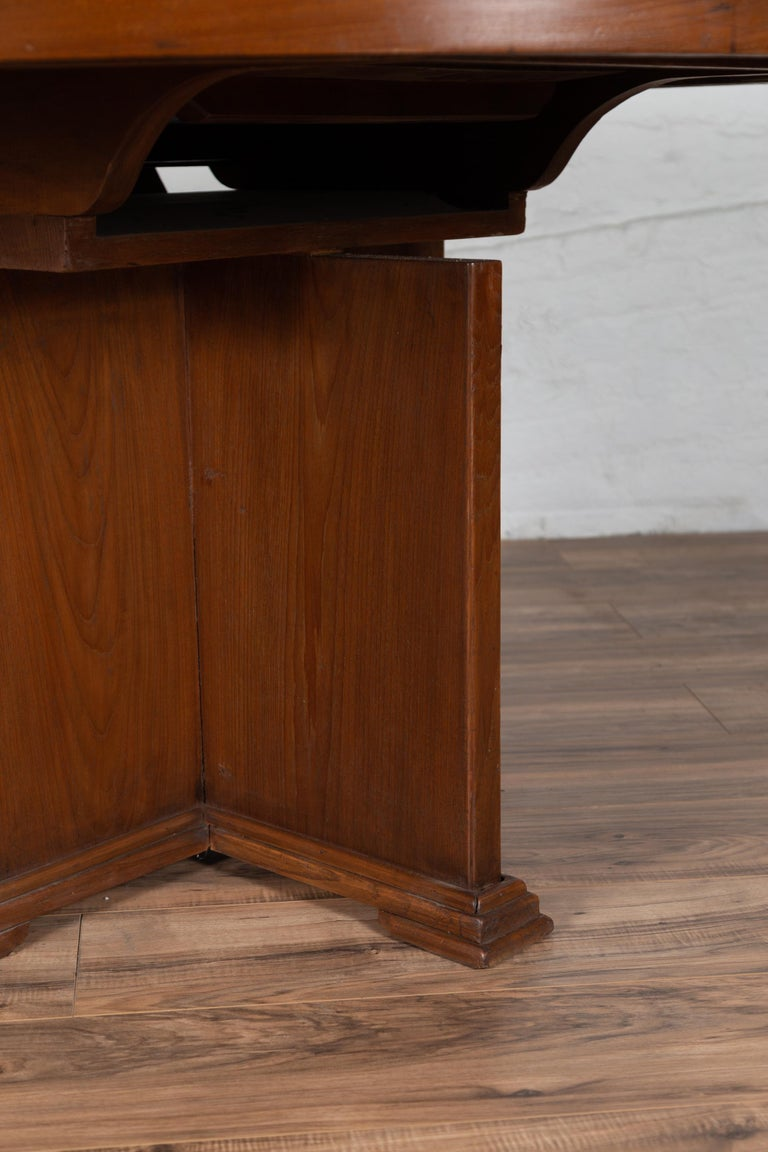 Antique Indonesian Dining Table with Central Folding Leaf and Geometric Base For Sale 5