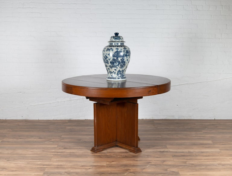 Antique Indonesian Dining Table with Central Folding Leaf and Geometric Base For Sale 7