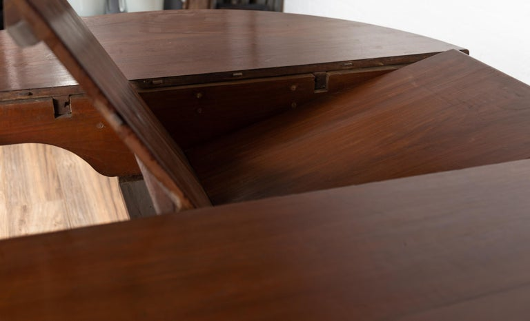 20th Century Antique Indonesian Dining Table with Central Folding Leaf and Geometric Base For Sale