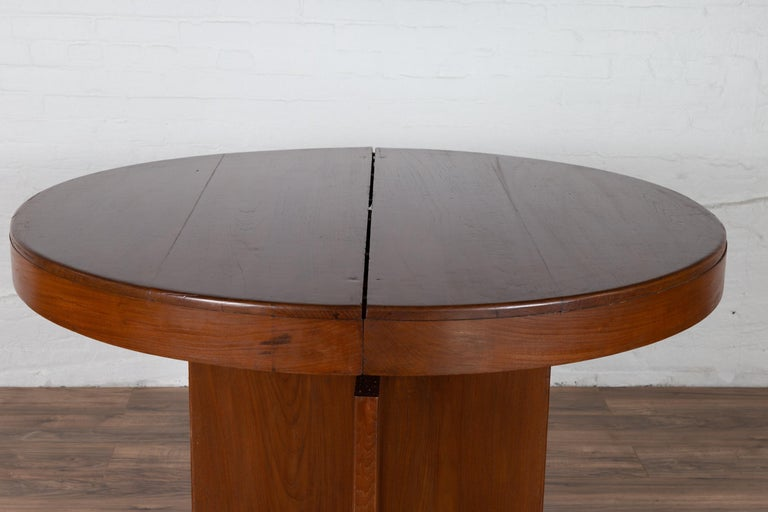 Antique Indonesian Dining Table with Central Folding Leaf and Geometric Base For Sale 1